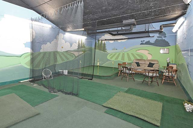 Indoor golf practice area.